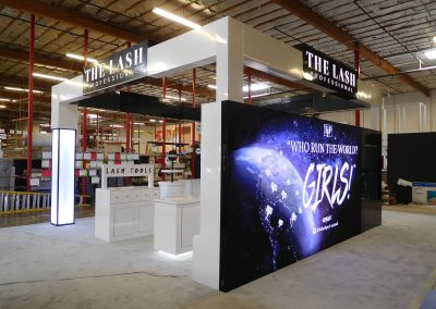 The Lash - modern custom trade show display with large backlit graphic wall