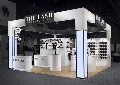 The Lash - Sleek 20x20 custom trade show exhibit with product shelving